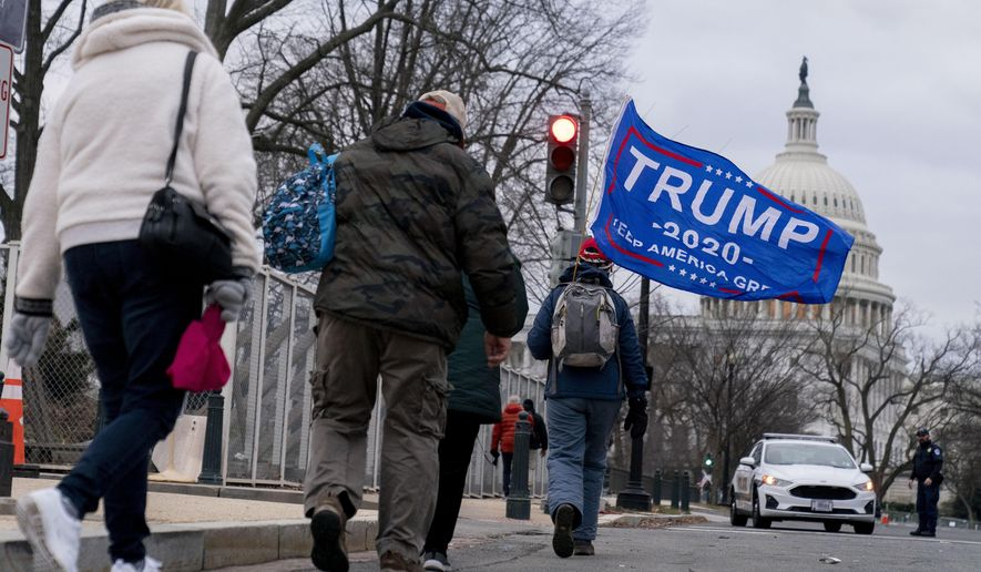 Trump supporters walk past the Dome of the Capitol Building in Washington, Wednesday, Jan. 6, 2021. (AP Photo/Andrew Harnik)