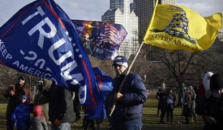 A Trump supporter protests outside on the State Capitol grounds, Wednesday, Jan. 6, 2021, in Hartford, Conn. Hundreds of protesters turned out for the swearing-in ceremonies.  (AP Photo/Jessica Hill)