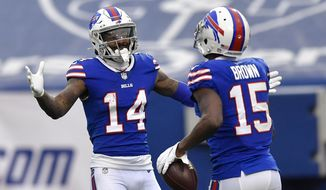 Buffalo Bills wide receiver John Brown (15) celebrates his touchdown with wide receiver Stefon Diggs (14) in the first half of an NFL football game against the Miami Dolphins, Sunday, Jan. 3, 2021, in Orchard Park, N.Y. (AP Photo/Adrian Kraus)