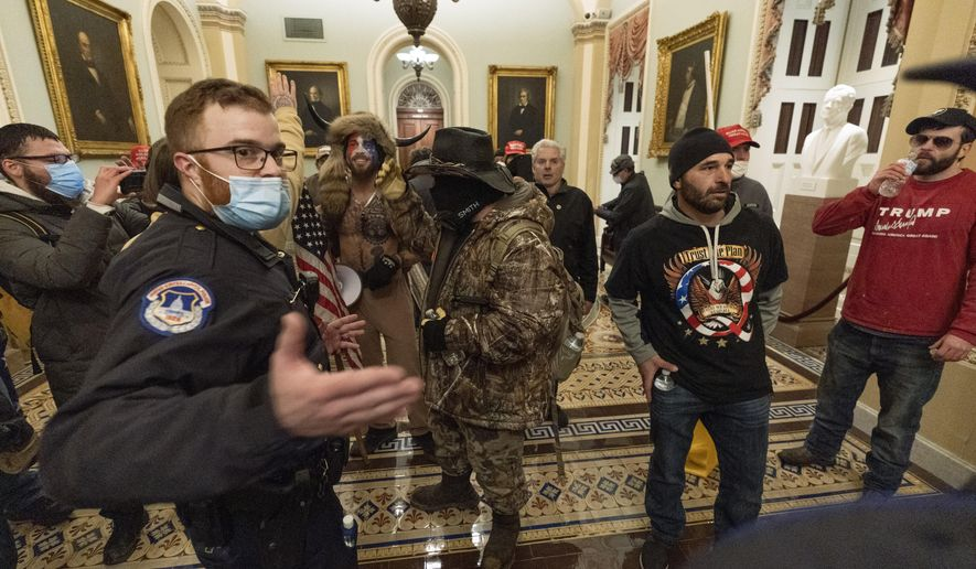 Supporters of President Donald Trump are confronted by Capitol Police officers outside the Senate Chamber at the Capitol, Wednesday, Jan. 6, 2021, in Washington. (AP Photo/Manuel Balce Ceneta) **FILE**