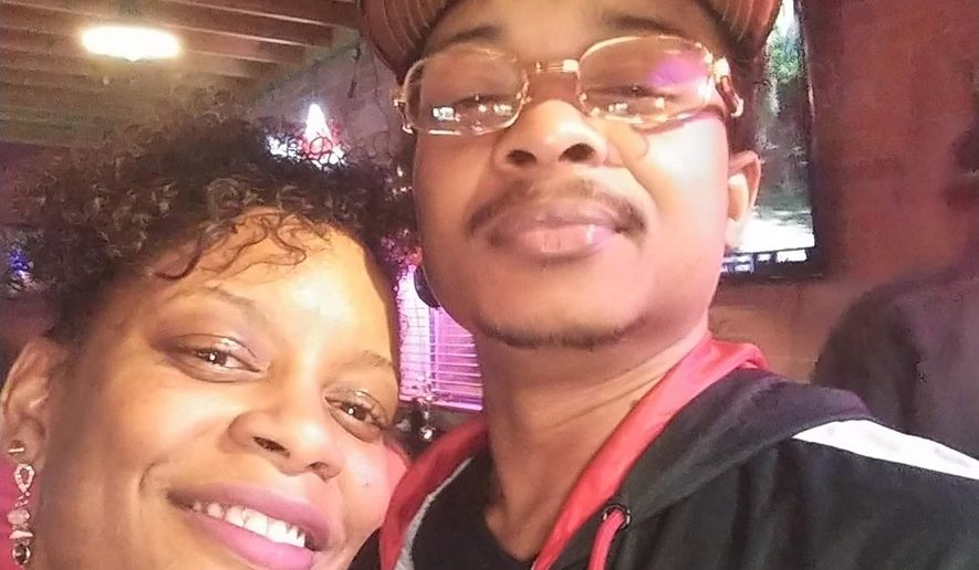 FILE - In this September 2019 file photo taken in Evanston, Ill., and provided by Adria-Joi Watkins, Watkins, left, poses in a selfie with her second cousin Jacob Blake. A police officer shot Blake in the back multiple times after responding to a domestic dispute on Aug. 23, 2020. On Tuesday, Jan. 5, 2021, a Wisconsin prosecutor declined to file criminal charges against the officer who shot Blake. (Adria-Joi Watkins via AP, File)