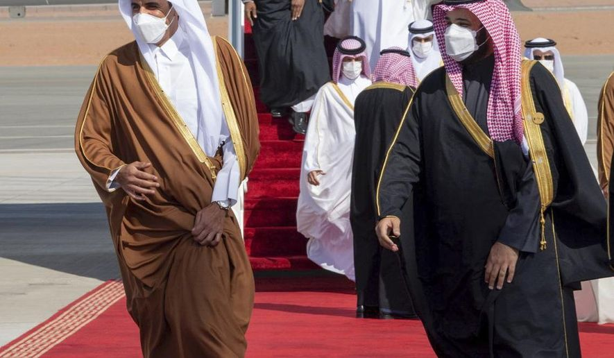 FILE - In this Jan. 5, 2021, file photo, provided by the Saudi Royal Court, Saudi Arabia's Crown Prince Mohammed bin Salman, right, welcomes Qatar's Emir Sheikh Tamim bin Hamad al-Thani upon his arrival to attend the Gulf Cooperation Council's 41st Summit in Al-Ula, Saudi Arabia. Qataris awoke to a surprise blockade and boycott by Gulf Arab neighbors 3 1/2 years ago, and this week were jolted again by the sudden announcement that it was all over. (Saudi Royal Court via AP, File)