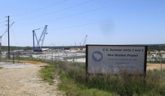 FILE - This April 9, 2012 file photo shows construction well underway for new nuclear reactors at the V.C. Summer Nuclear Station in Jenkinsville, S.C.  Lawmakers have again started debating the future of Santee Cooper, which was a minority partner in the failed project, even before the 2021 General Assembly session began. (AP Photo/Jeffrey Collins, File)