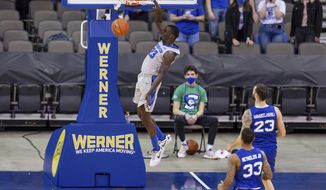 Creighton forward Damien Jefferson (23) dunks during the first half against Seton Hall in an NCAA college basketball game Wednesday, Jan. 6, 2021, in Omaha, Neb. (AP Photo/John Peterson)