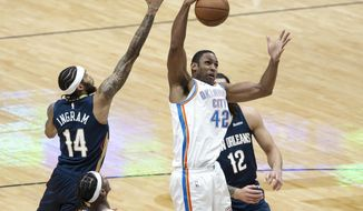 Oklahoma City Thunder center Al Horford (42) rebounds over New Orleans Pelicans forward Brandon Ingram (14) in the third quarter of an NBA basketball game in New Orleans, Wednesday, Jan. 6, 2021. (AP Photo/Derick Hingle)