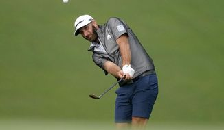Dustin Johnson chips onto the ninth green during a practice round prior to the Tournament of Champions golf event, Wednesday, Jan. 6, 2021, at Kapalua Plantation Course in Kapalua, Hawaii. (AP Photo/Matt York)
