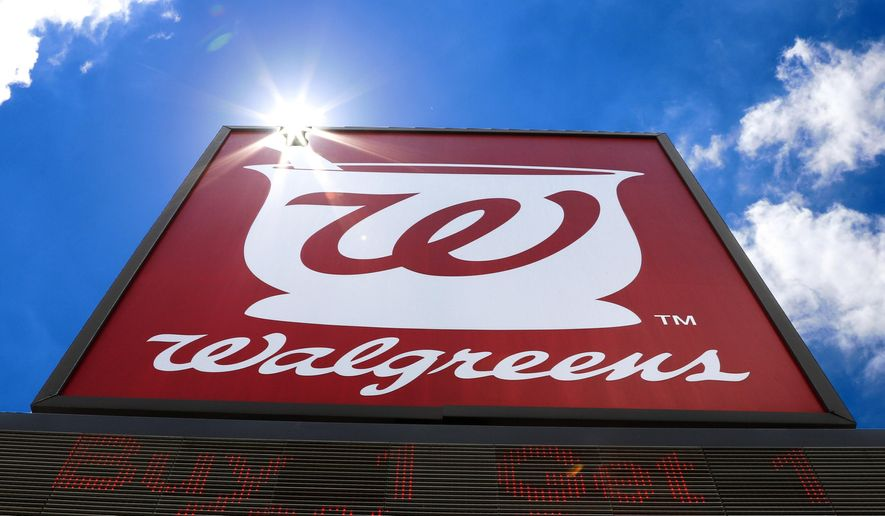 FILE - This June 25, 2019, file photo shows the sign outside a Walgreens Pharmacy in Pittsburgh. Walgreens Boots Alliance will sell its pharmaceutical wholesaler business to AmerisourceBergen in $6.5 billion cash and stock deal. The drugstore chain says the deal will let it invest in and focus on its retail business, which has been hurt by sales declines during the COVID-19 pandemic.  (AP Photo/Gene J. Puskar, File)