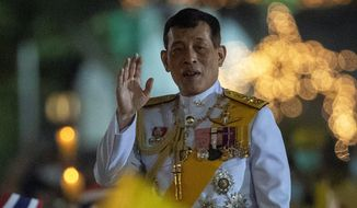 Thai King Maha Vajiralongkorn, 68, faces a balancing act to maintain his position of strength during 2021 while trying to adapt to an increasingly international public spotlight. greets supporters as he walks to participate in a candle lighting ceremony to mark the anniversary of the birth of late King Bhumibol Adulyadej at Sanam Luang ceremonial ground in Bangkok, Thailand, Saturday, Dec. 5, 2020. Thousands of yellow-clad supporters greeted Thailand's king in Bangkok on Saturday as he led a birthday commemoration for his revered late father, the latest in a series of public appearances at a time of unprecedented challenge to the monarchy from student-led protesters.(AP Photo/Gemunu Amarasinghe) (ASSOCIATED PRESS PHOTOGRAPHS)