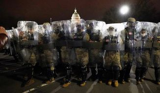 About 6,200 National Guard troops will be in Washington by the end of the weekend to keep the peace after the breach of the Capitol by pro-Trump supporters on Wednesday. (Associated Press)