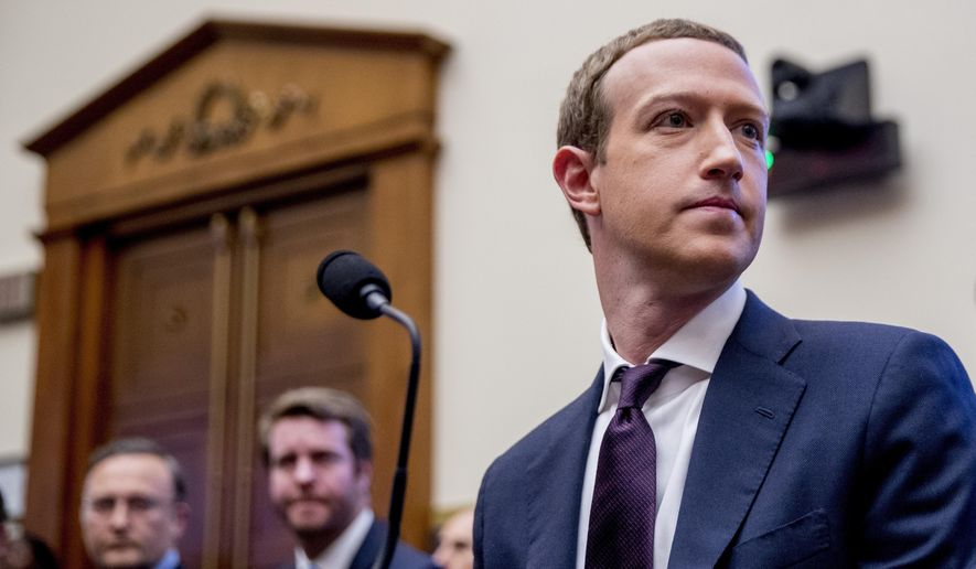 In this Wednesday, Oct. 23, 2019, file photo, Facebook CEO Mark Zuckerberg arrives for a House Financial Services Committee hearing on Capitol Hill in Washington, on Facebook's impact on the financial services and housing sectors.  (AP Photo/Andrew Harnik, File)  **FILE**