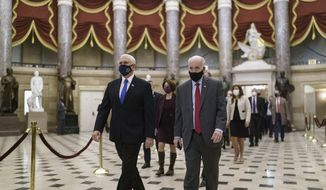 Senate Sergeant-at-Arms Michael Stenger, right, escorts Vice President Mike Pence to the House chamber for the the final certification of Electoral College votes cast in November's presidential election, at the Capitol in Washington, Thursday, Jan. 7, 2021. Violent protesters loyal to President Donald Trump stormed the Capitol Wednesday, disrupting the Electoral College process. (AP Photo/J. Scott Applewhite)