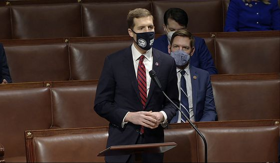 In this image from video, Rep. Conor Lamb, D-Pa., speaks as the House debates the objection to confirm the Electoral College vote from Pennsylvania, at the U.S. Capitol early Thursday, Jan. 7, 2021. (House Television via AP)