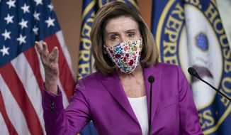 Speaker of the House Nancy Pelosi, D-Calif., holds a news conference on the day after violent protesters loyal to President Donald Trump stormed the U.S. Congress, at the Capitol in Washington, Thursday, Jan. 7, 2021. (AP Photo/J. Scott Applewhite)
