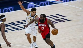Houston Rockets guard James Harden (13) drives past Indiana Pacers guard Malcolm Brogdon (7) during the fourth quarter of an NBA basketball game in Indianapolis, Wednesday, Jan. 6, 2021. (AP Photo/Michael Conroy) **FILE**