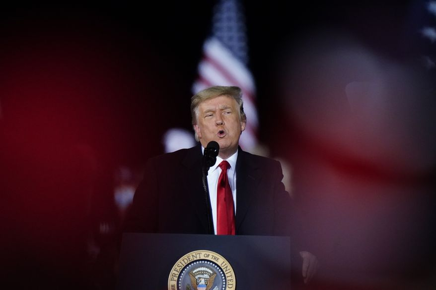 President Donald Trump speaks at a campaign rally in support of Senate candidates Sen. Kelly Loeffler, R-Ga., and David Perdue in Dalton, Ga., Monday, Jan. 4, 2021. (AP Photo/Brynn Anderson)