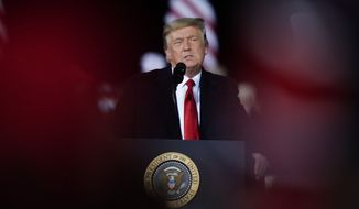 President Donald Trump speaks at a campaign rally in support of Senate candidates Sen. Kelly Loeffler, R-Ga., and David Perdue in Dalton, Ga., Monday, Jan. 4, 2021. (AP Photo/Brynn Anderson)