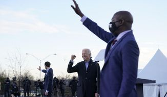 President-elect Joe Biden campaigns in Atlanta, Monday, Jan. 4, 2021, for Senate candidates Raphael Warnock, right, and Jon Ossoff, left. (AP Photo/Carolyn Kaster)