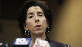 FILE - In this March 1, 2020 file photo, Rhode Island Gov. Gina Raimondo faces reporters during a news conference, in Providence, R.I. President-elect Joe Biden has picked Rhode Island Gov. Gina Raimondo to lead the Commerce Department.  (AP Photo/Steven Senne)