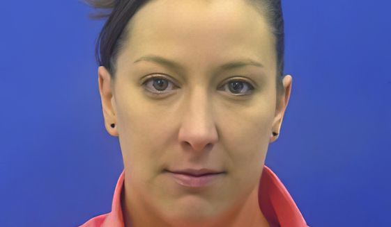 This driver's license photo from the Maryland Motor Vehicle Administration (MVA), provided to AP by the Calvert County Sheriff's Office, shows Ashli Babbitt. Babbitt was fatally shot by an employee of the Capitol Police inside the U.S. Capitol building in Washington on Wednesday, Jan. 6, 2021, while the rioters were moving toward the House chamber. (Maryland MVA/Courtesy of the Calvert County Sheriff's Office via AP)