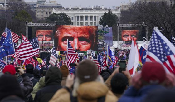 In this Jan. 6, 2021, file photo, Trump supporters participate in a rally in Washington. Far-right social media users for weeks openly hinted in widely shared posts that chaos would erupt at the U.S. Capitol while Congress convened to certify the election results. (AP Photo/John Minchillo, File)