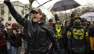 Protesters confront riot police as they gathered at the Capitol on Wednesday, Jan. 6, 2021 in Salem, Ore. Thousands of President Donald Trump's supporters caused violence and chaos in Washington while Congress attempted to vote to certify that President-elect Joe Biden won the election. (AP Photo/Paula Bronstein)