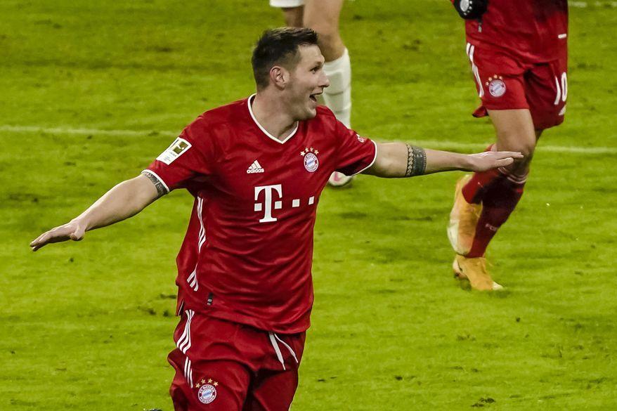 Bayern Munich's German defender Niklas Suele celebrates scoring during the German first division Bundesliga football match between FC Bayern Munich and Mainz 05 in Munich, Germany, Sunday Jan. 3, 2021. (Guenter Schiffmann/Pool via AP)