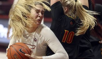 Virginia Tech's Elizabeth Kitley drives on Louisville's Hailey Van Lith 10 during the first half of an NCAA college basketball game Thursday, Jan. 7, 2021, in Blacksburg, Va. (Matt Gentry/The Roanoke Times via AP, Pool)