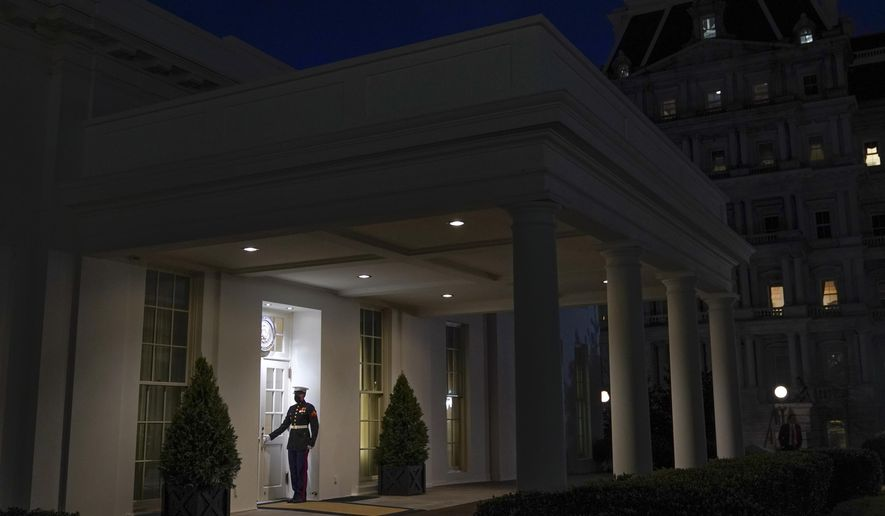 A Marine stands outside the entrance to the West Wing of the White House, signifying President Donald Trump is in the Oval Office, Thursday, Jan. 7, 2021, in Washington. (AP Photo/Patrick Semansky)