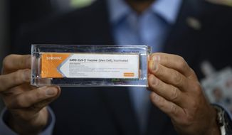 Brazilian officials have been testing the COVID-19 vaccine CoronaVac, made by the Chinese pharmaceutical company Sinovac, since November and say it is effective. (AP Photo/Andre Penner)