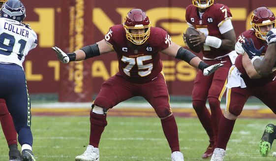 Washington Football Team offensive guard Brandon Scherff (75) blocks during an NFL football game against the Seattle Seahawks in Landover, Md., in this Sunday, Dec. 20, 2020, file photo. Scherff was selected Friday, Jan. 8, 2021, to The Associated Press All-Pro Team. (AP Photo/Daniel Kucin Jr., File)  **FILE**