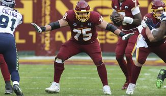 FILE - Washington Football Team offensive guard Brandon Scherff (75) blocks during an NFL football game against the Seattle Seahawks in Landover, Md., in this Sunday, Dec. 20, 2020, file photo. Scherff was selected Friday, Jan. 8, 2021, to The Associated Press All-Pro Team. (AP Photo/Daniel Kucin Jr., File)