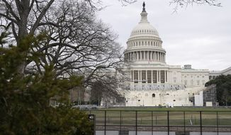Preparations take place for President-elect Joe Biden's inauguration behind security fencing protecting the West Front of the U.S. Capitol in Washington, Friday, Jan. 8, 2021, after supporters of President Donald Trump stormed the building. (AP Photo/Patrick Semansky)