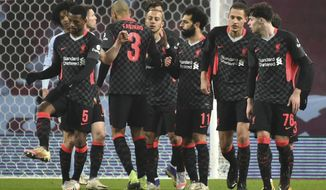 Liverpool's Mohamed Salah celebrates after scoring his side's fourth goal during the FA Cup 3rd round soccer match between Aston Villa and Liverpool at Villa Park stadium in Birmingham, England, Friday, Jan. 8, 2021. (AP Photo/Rui Vieira)