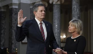 FILE - In this Jan. 3, 2021, file photo, Sen. Steve Daines, R-Mont., joined by his wife Cindy Daines, raises his hand to take the oath of office from Vice President Mike Pence during a reenactment ceremony in the Old Senate Chamber at the Capitol in Washington. After months of tacitly or directly supporting President Donald Trump's denial of the results of the 2020 election, top Montana Republicans denounced the violence that took over the nation's Capitol and delayed Congress' certification of the presidential election for Joe Biden. But one of them doubled down. (AP Photo/J. Scott Applewhite, Pool, File)