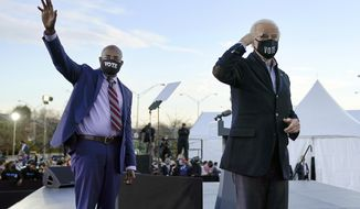 FILE - In this Monday, Jan. 4, 2021 file photo, President-elect Joe Biden, right, campaigns for Senate candidates Raphael Warnock, left, and Jon Ossoff, not pictured, in Atlanta. Sen.-elect Warnock shares more than a party with Biden: Both Democrats made faith a central part of their political identity on the campaign trail — and their victories are emboldening religious liberals. (AP Photo/Carolyn Kaster)