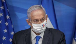 Israeli Prime Minister Benjamin Netanyahu delivers a statement following his meeting with US Secretary of Treasury Steven Mnuchin, in Jerusalem, Thursday, Jan. 7, 2021. (Emil Salman/Pool via AP)