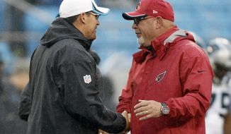 FILE - In this Jan., 3, 2015 file photo, Carolina Panthers coach Ron Rivera, left, greets Arizona Cardinals coach Bruce Arians before an NFL wild-card playoff football game in Charlotte, N.C. Rivera is now the coach of the Washington Football Team, and Arians is the coach of the Tampa Bay Buccaneers. Those two teams meet in the wild-card round this weekend; Washington was 7-9 in the regular season. (AP Photo/Bob Leverone, File)