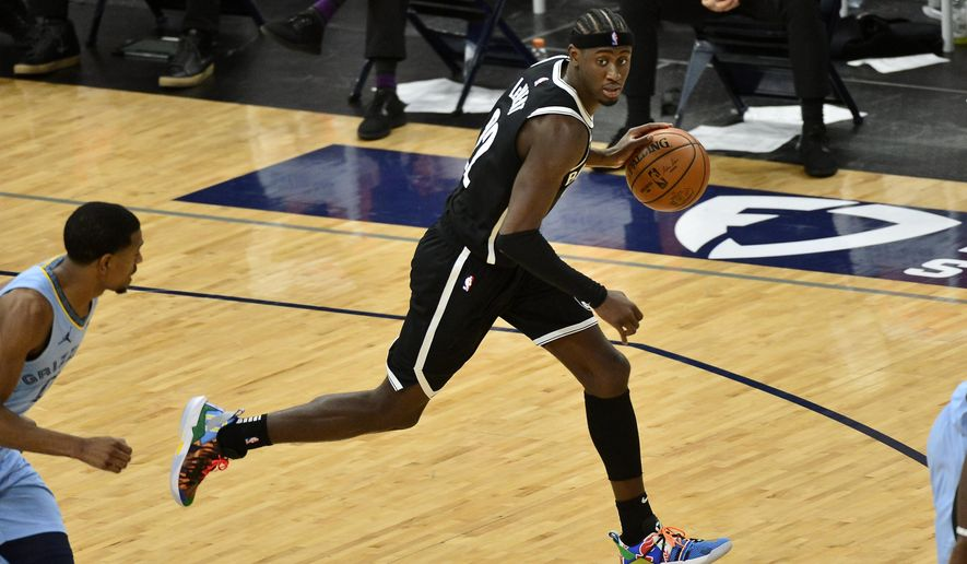 Brooklyn Nets guard Caris LeVert (22) brings the ball upcourt in the second half of an NBA basketball game against the Memphis Grizzlies, Friday, Jan. 8, 2021, in Memphis, Tenn. (AP Photo/Brandon Dill)