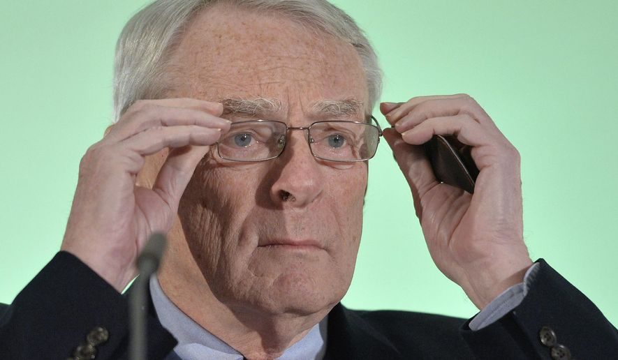 """FILE - In this Jan 14, 2016 file photo Canadian Richard Pound, Chairman of WADA's (World Anti-Doping Agency) Independent Commission (IC), presents the findings of his Commission's Report surrounding allegations of doping in sport, during a press conference in Munich, Germany. Pound, a senior member of the International Olympic Committee, has said Friday, Jan. 8, 2021, that he """"can't be certain""""the postponed Tokyo Olympics will open in just over six months. Pound made the comments to the British broadcaster the BBC. (AP Photo/Kerstin Joensson, file)"""
