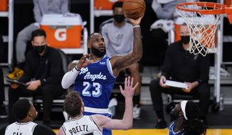 Los Angeles Lakers forward LeBron James (23) shoots during the second quarter of the team's NBA basketball game against the San Antonio Spurs on Thursday, Jan. 7, 2021, in Los Angeles. (AP Photo/Ashley Landis)