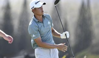 Collin Morikawa watches his shot during the second round of the Tournament of Champions golf event, Friday, Jan. 8, 2021, at Kapalua Plantation Course in Kapalua, Hawaii. (Matthew Thayer/The Maui News via AP)