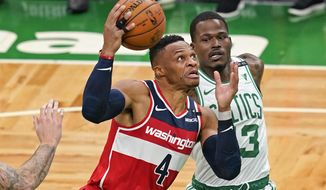 Washington Wizards guard Russell Westbrook (4) drives against Boston Celtics guard Javonte Green during the first quarter of an NBA basketball game Friday, Jan. 8, 2021, in Boston. (AP Photo/Elise Amendola)  **FILE**