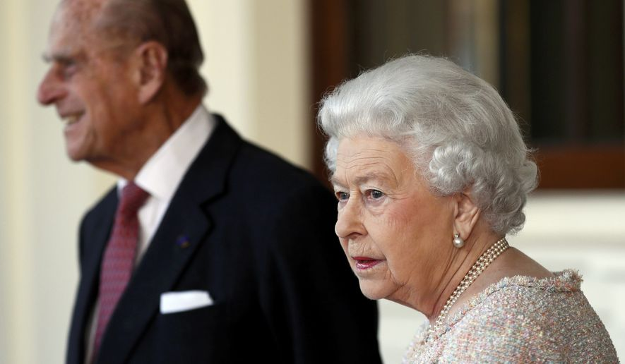 In this Thursday, Nov. 3, 2016 file photo, Britain's Prince Philip and Queen Elizabeth II bid farewell to Colombia's President Juan Manuel Santos, and his wife Maria Clemencia de Santos, following their state visit, at Buckingham Palace in London. Queen Elizabeth II and her husband have received their COVID-19 vaccinations. Buckingham Palace officials said in a statement that the 94-year-old monarch and 99-year-old Prince Philip received their jabs on Saturday, Jan. 9, 2021, joining some 1.5 million people in Britain who have been given the first dose of a vaccine against the coronavirus. (Stefan Wermuth/Pool Photo via AP, File)  **FILE**