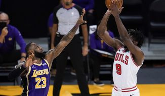 Los Angeles Lakers forward LeBron James (23) defends against Chicago Bulls forward Patrick Williams (9) during the second quarter of an NBA basketball game Friday, Jan. 8, 2021, in Los Angeles. (AP Photo/Ashley Landis)