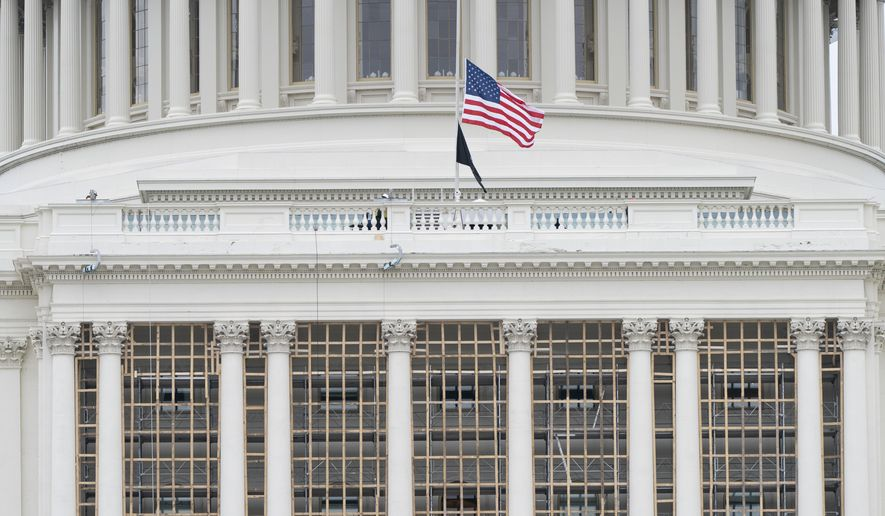 The U.S. flag is at half-staff in memory of Capitol Police Officer Brian Sicknick, Friday, Jan. 8, 2021, in Washington. Sicknick died of injuries he received from rioters on Wednesday. (AP Photo/Jacquelyn Martin)