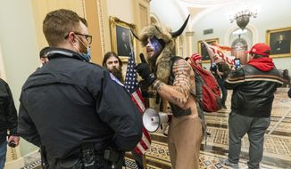 Rioters are confronted by U.S. Capitol Police officers outside the Senate Chamber inside the Capitol in Washington, Jan. 6, 2021. (AP Photo/Manuel Balce Ceneta, File)  **FILE**