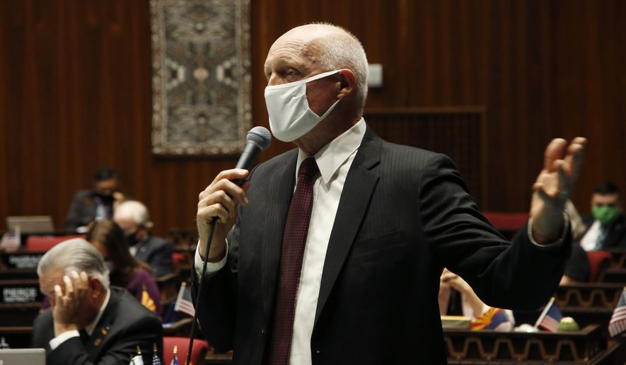 FILE - In this May 19, 2020, file photo, Arizona House Speaker Rusty Bowers, R-Mesa, speaks during a vote in the Arizona House of Representatives in Phoenix. The Arizona Legislature returns to start its 2021 session Monday, Jan. 11, 2021, in the midst of a pandemic that is enveloping the state and has potential to derail action for the second consecutive year. (AP Photo/Ross D. Franklin, File)