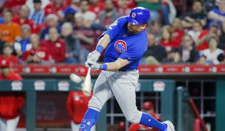 In this May 15, 2019, file photo,  Chicago Cubs' Kyle Schwarber hits a solo home run off Cincinnati Reds relief pitcher David Hernandez in the eighth inning of a baseball game in Cincinnati. Schwarber agreed in principle to a one-year, $10 million contract with the Washington Nationals, according to a person familiar with the deal. The person confirmed the agreement to The Associated Press on condition of anonymity on Saturday, Jan. 9, 2021,  because a physical exam was still pending for Schwarber. (AP Photo/John Minchillo, File) **FILE**