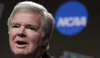 In this April 4, 2019, file photo, NCAA President Mark Emmert answers questions during a news conference at the Final Four college basketball tournament in Minneapolis. The NCAA is set to delay a potential landmark vote on legislation that would permit college athletes to be compensated for their fame for the first time after the association received a warning from the Department of Justice about potential antitrust violations. NCAA President Mark Emmert on Saturday, Jan. 9, 2020, emailed a letter to Makan Delrahim, assistant attorney general of the DOJ's antitrust division, saying he strongly recommended putting off votes on new name, image and likeness rules by two key legislative bodies that had been scheduled for next week. (AP Photo/Matt York, File) **FILE**