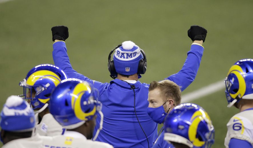 A Los Angeles Rams coach reacts to the team defeating the Seattle Seahawks in an NFL wild-card playoff football game, Saturday, Jan. 9, 2021, in Seattle. (AP Photo/Scott Eklund)